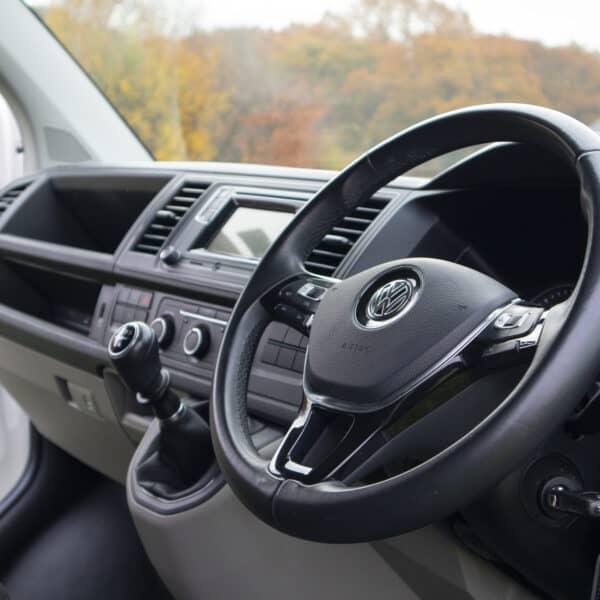 The steering wheel of a campervan