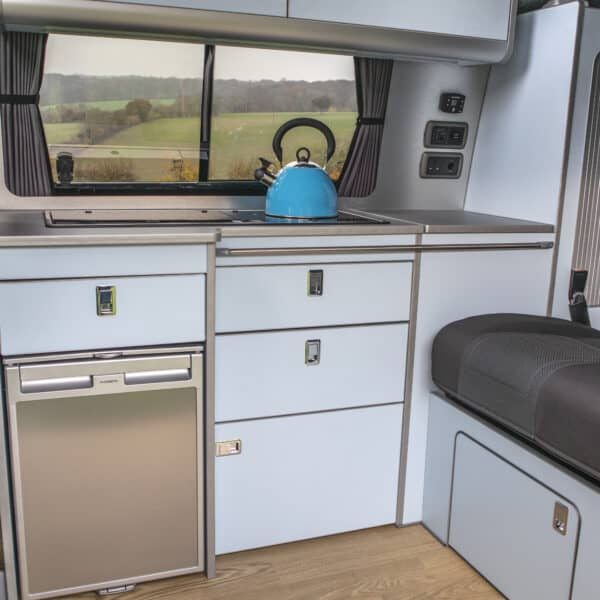 Kitchen and rear seats of a campervan