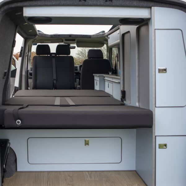Rearview of the campervan with bed flattened