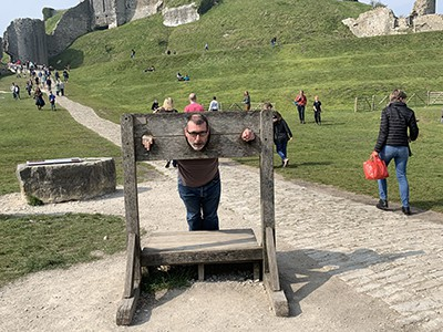 Inside the stocks at Corfe Castle