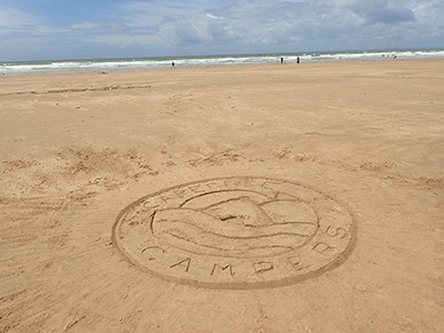 Carefree Campers logo in the sand