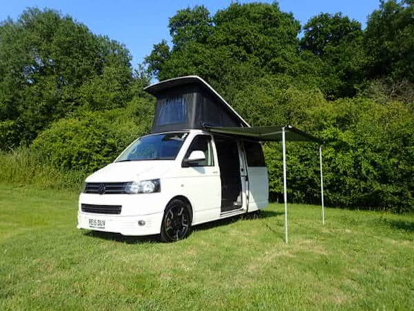 Jossiee the campervan with the awning out in a field