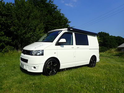 Side view of a VW T5 Campervan parked in a field