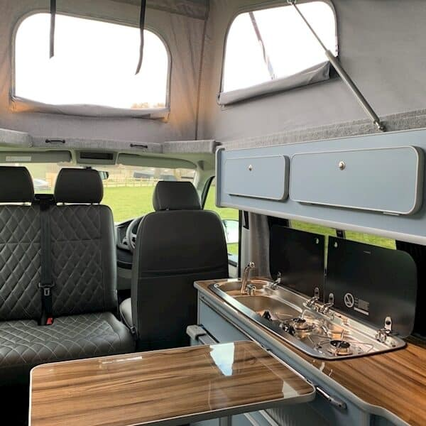 Campervan front seat swivelled around with the table out