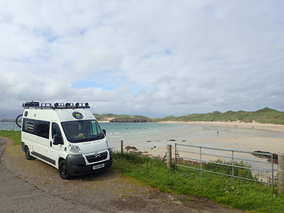 Adventure van parked on the side of Balnakeil Bay on NC500