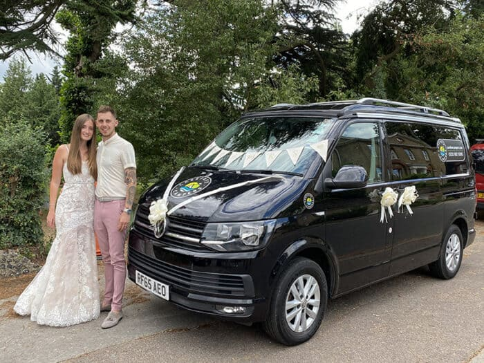 A recently married couple with Carefree Campers Van