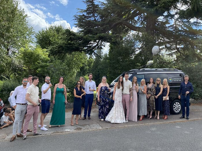 A group of people after a wedding with Carefree Campers Van