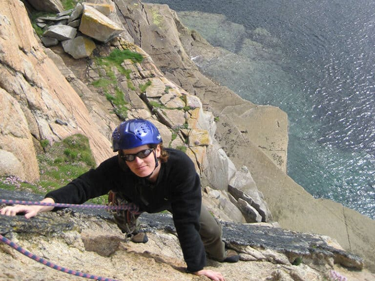 Person climbing on the cliffs in Dorset