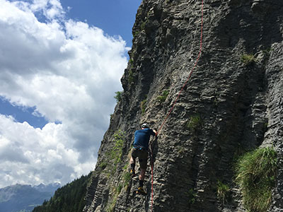 A man cliff climbing in France