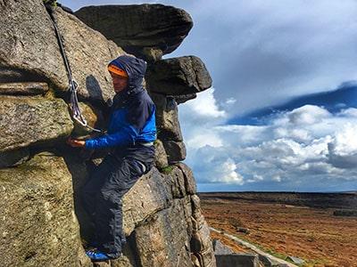 Man climbing on Stanage Edge