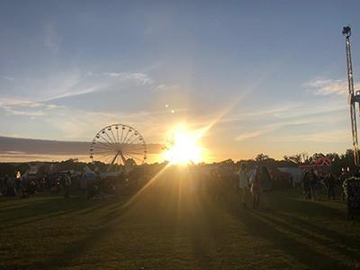 Campervan festival at sunset