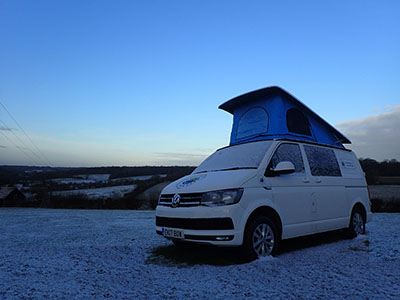 Campervan parked in the snow