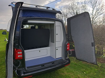 Campervan with back doors open