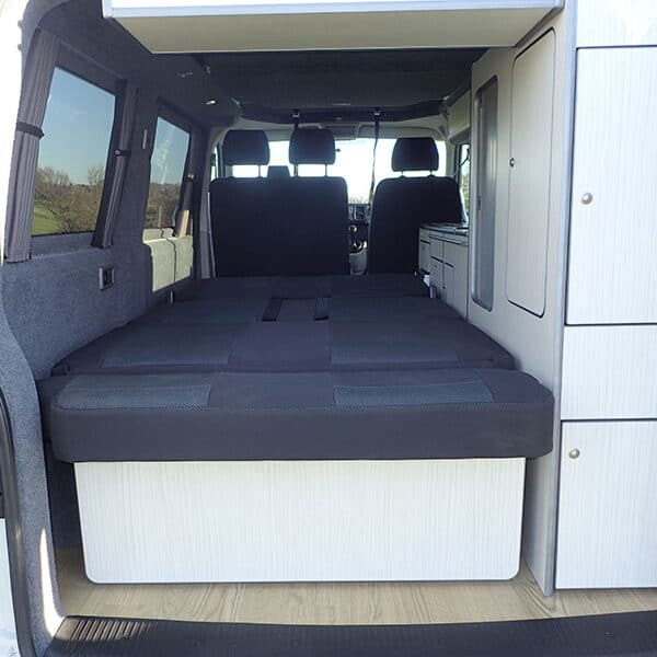 Campervan with bed down from the back