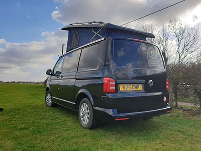 Campervan from the back with roof open