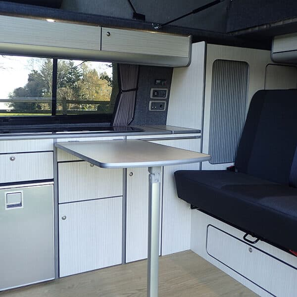 Campervan kitchen with table out