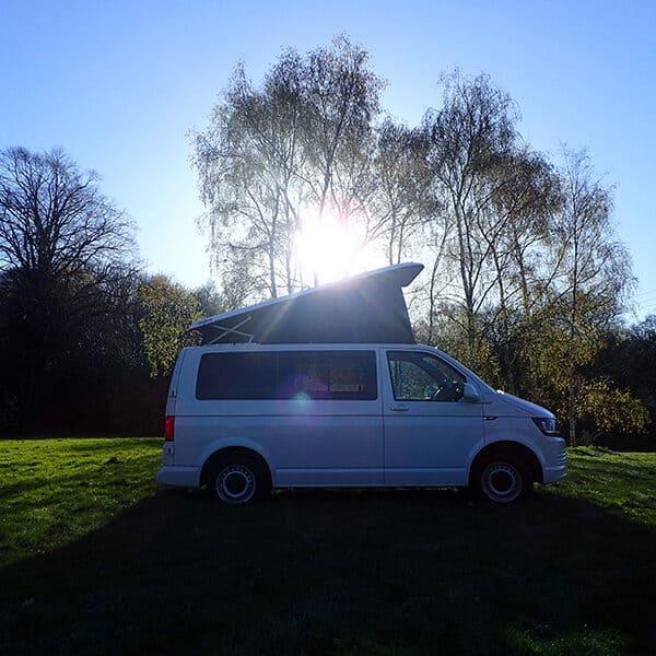 Campervan with sunlit back drop