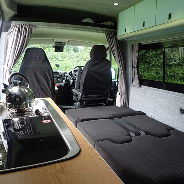 Campervan bed down and kettle on