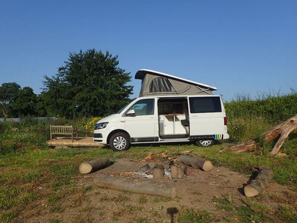 Campervan camped by a fire place