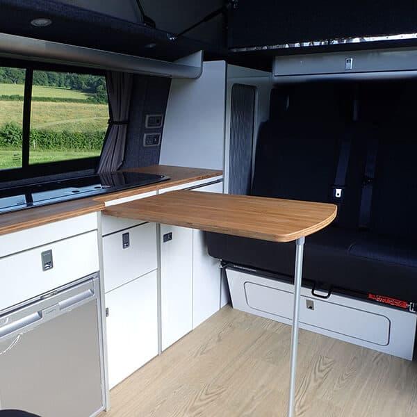 Campervan kitchen unit and rea seats
