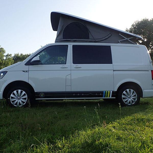 Campervan parked in a field