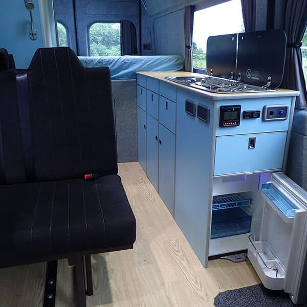 Campervan rear seats and cooking area